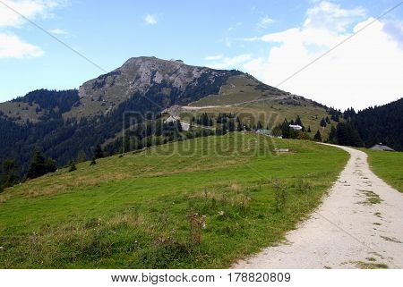 Travel To Sankt-wolfgang, Austria. The Road Between The Fields In The Mountains.