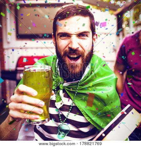 Flying colours against disguised man holding green pint 3d