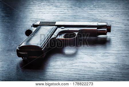 Photo of beretta gun on the black background