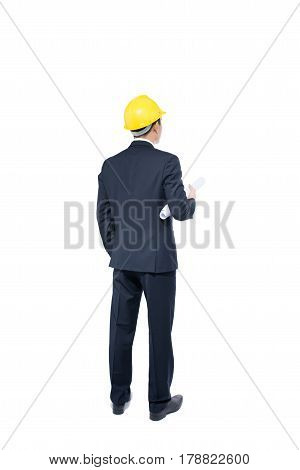 Back View Of Businessman In Formal Wear And Red Helmet Holding Blueprint. Isolated On White Backgrou