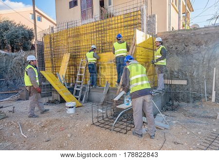 Tivat, Montenegro- December 28, 2016:Team of workers working on a new building construction site