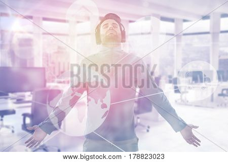Man with arms outstretched while listening music against interior of empty office 3d