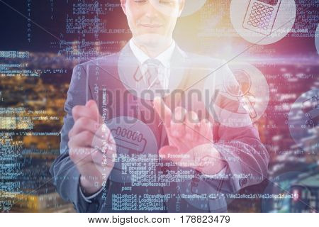 Businessman using futuristic digital tablet against high angle view of illuminated crowded cityscape 3d