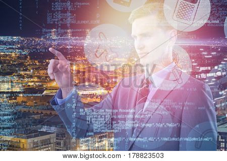 Young smart businessman pointing against high angle view of illuminated crowded cityscape 3d
