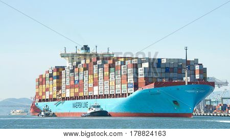 Oakland CA - March 14 2017: Cargo ships CRETE MAERSK CAP PASLEY and KAUAI entering the Port of Oakland the fifth busiest port in the United States.