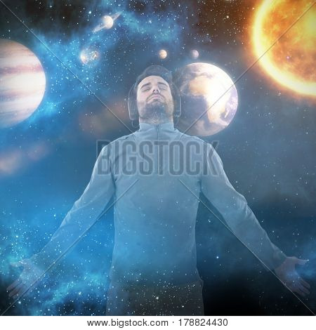 Man with arms outstretched while listening music against graphic image of solar system 3d