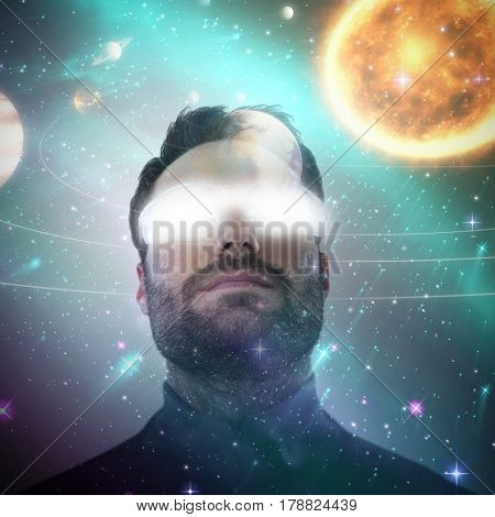 Low angle view of man wearing protective eyewear against composite image of solar system against white background 3d
