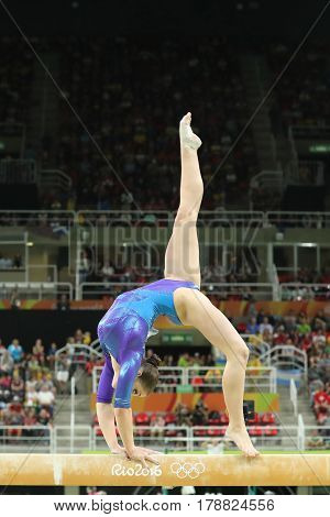 RIO DE JANEIRO, BRAZIL - AUGUST 11, 2016: Artistic gymnast Aliya Mustafina of Russian Federation competes on the balance beam at women's all-around gymnastics at Rio 2016 Olympic Games