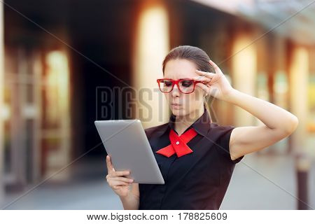 Discontent Businesswoman with Pc Tablet and Red Glasses