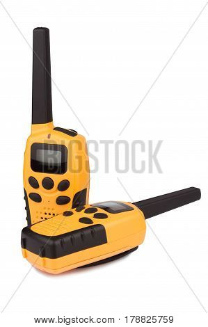 front view of a pair of yellow walkie talkie with black keypad isolated on white background