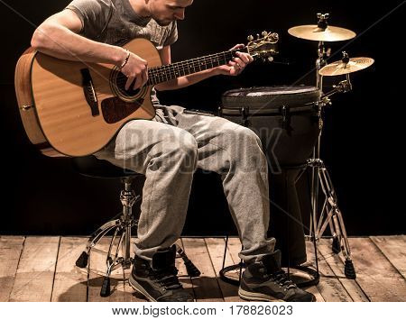 Musician Plays Acoustic Guitar And Percussion Instruments, Black
