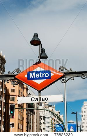 Madrid Spain - September 18 2016: Madrid Metro sign at the entrance to Callao station at Gran Via Street in Madrid. Low angle view vertical composition