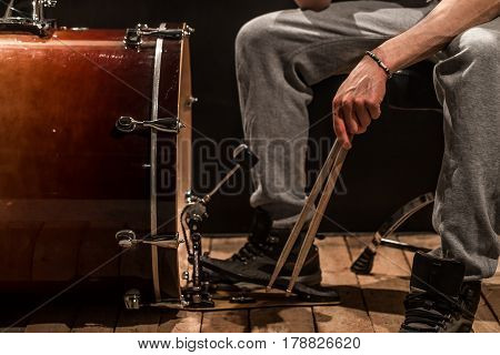 Man Playing The Bass Drum, Wood Board With A Black Background