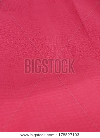 Fabric Texture Close Up of Pink Textile Pattern Background. Selective Focus.