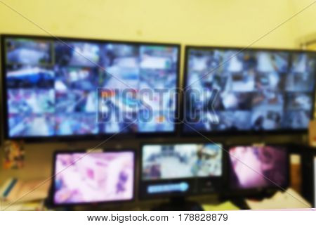 blurred photo, Blurry image, closed circuit camerasecurity system walkie-talkie while looking at CCTV footage.