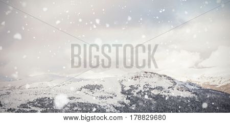 Scenic view of snow mountains against cloudy sky