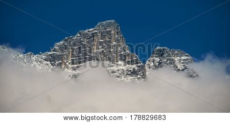 View of beautiful snowy mountain range and clouds