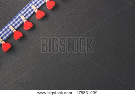 Decorative Clothespins On The Blue Plaid Fabric, Stone Background