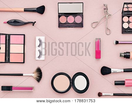 Fashion Cosmetic Makeup Set. Woman Beauty Accessories Set. Essentials. Makeup background. Fashion Design. Lipstick Brushes Eyeshadow, fashion Eyelashes. Minimal Concept. Top view. Cosmetic Overhead