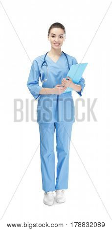 Beautiful young medical assistant on white background