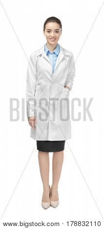 Beautiful young doctor on white background