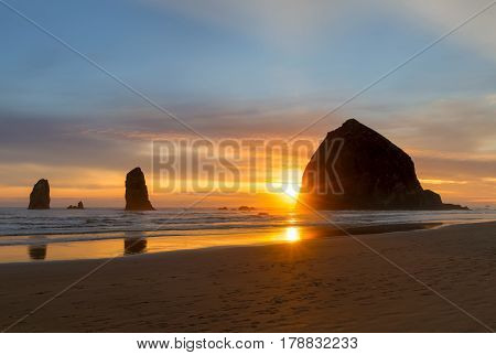 Haystack Rock and the Needles at Cannon Beach on the Oregon Coast during Sunset