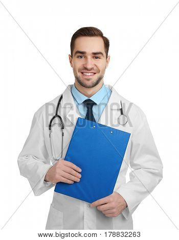 Handsome young doctor with clipboard on white background