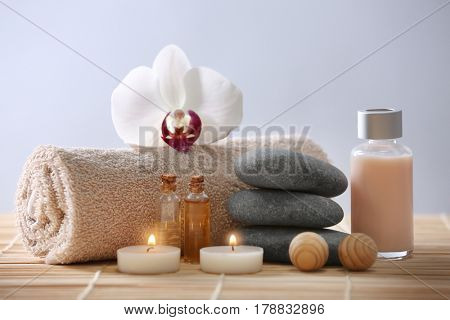 Spa composition with flower on color background