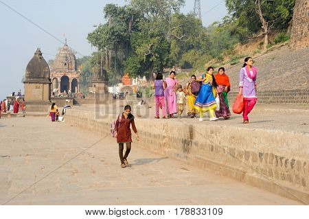 Woman Walking On The Ghat Of Maheshwar On India
