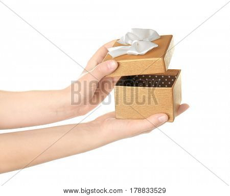 Hands opening beautiful gift box on white background