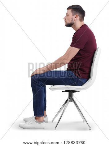 Posture concept. Man sitting on chair against white background