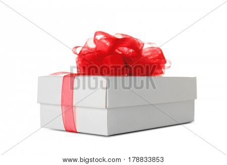 Beautiful gift box with red ribbon on white background