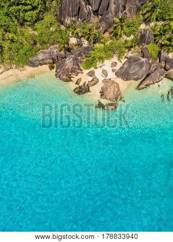 Aerial photo of beautiful paradise Seychelles tropical beach Anse Source D Argent at La Digue island. Summer vacation and travel concept