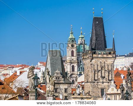 Charles Bridge Tower and St Nicholas Church in the background, Prague, Czech Republic