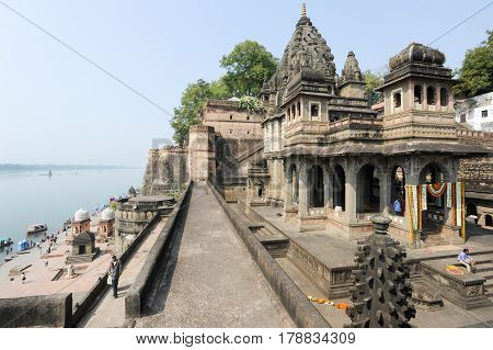 People Walking In Front Of Maheshwar Palace On India