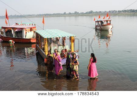 Woman Standing On Sacred River Narmada At Maheshwar