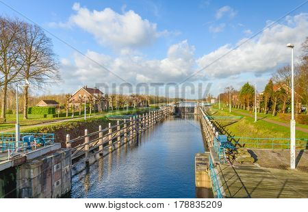 The Wilhelminasluis is a lock in the river Afgedamde Maas near the Dutch village of Andel in the province of North Brabant. The lock was built around the year 1896.