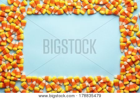 Colorful Halloween candy corns on blue background
