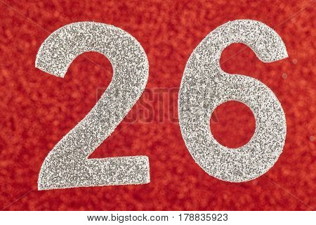 Number twenty-six silver color over a red background. Anniversary. Horizontal