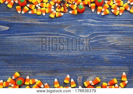 Tasty Halloween candies on wooden background