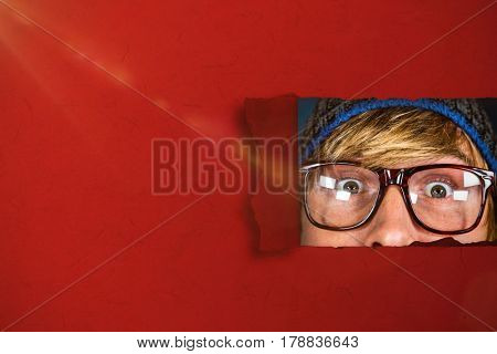 Close up of half face of hipster man against blue background with vignette 3d