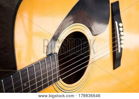 Wooden Yellow Classic Acoustic Guitar stock photo