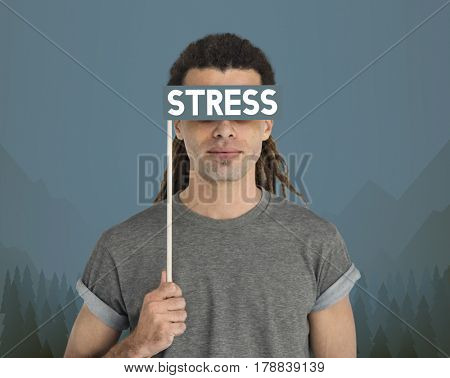 Guy holding a banner with the word stress to his eyes