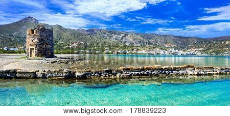 Pictorial scenery with old windmill and crystal waters in Elounda. Crete island , Greece