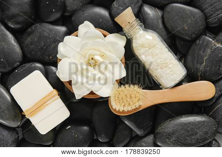 Set of with soap, gardenia in bowl, stones, brush