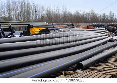 Tube rolling plant. Storage of new plastic pipes ready for use. pvc pipes