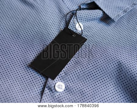 Label price tag on blue shirt. Mockup for price or brand presentation.