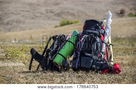 close-up of two tourist backpack at nature
