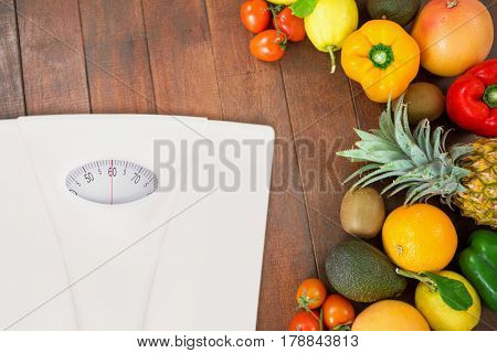 weighting scale against overhead view of assortment of fresh fruits