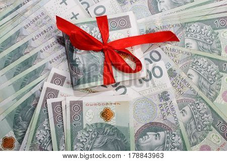 Polish Money And Red Ribbon. Banknotes From Poland As A Gift. Business, Technology, Internet Concept